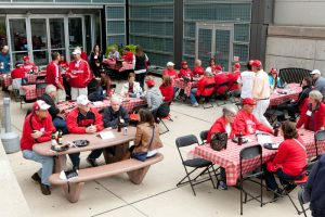 alumni eating at tables outside of the law school