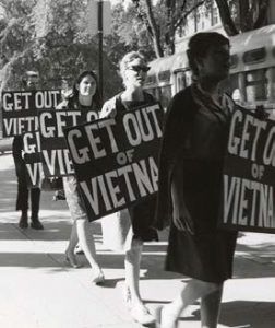 "vietnam protesters holding ""get out of vietnam"" signs"