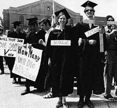 recent graduates protesting vietnam in cap and gown