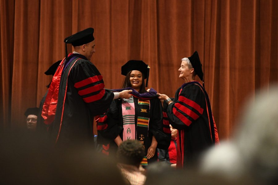 student being hooded at UW Law graduation, May 2019
