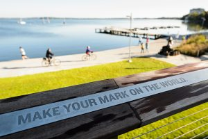 """Sign at Alumni Park that says """"Make your mark on the world"""""""
