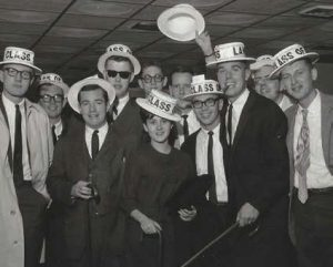 group of students with cane toss hats and canes