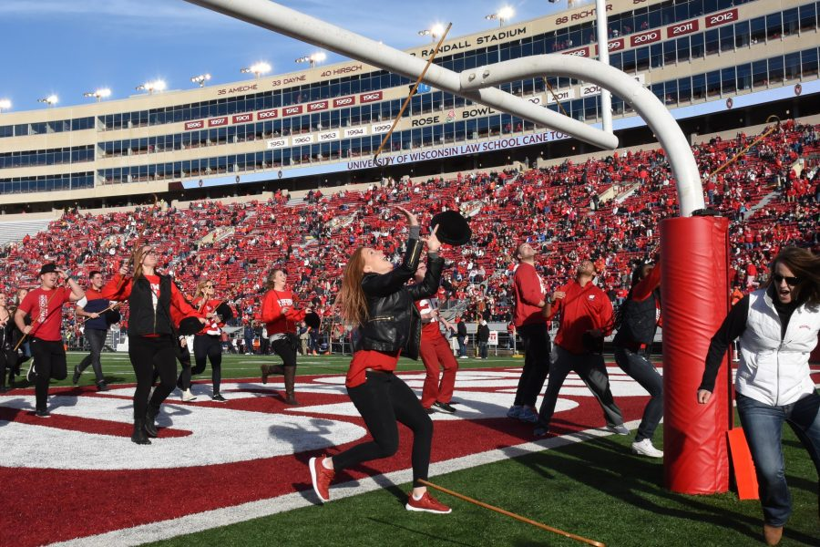 Students tossing their canes over the field goal on Camp Randall, 2016