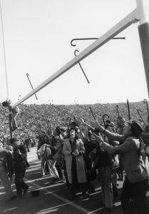 student tossing their cane on camp randall