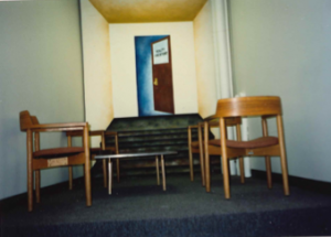 chairs and desks in a small hallway