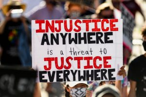 "BLM march sign: ""Injustice anywhere is a threat to justice everywhere"""