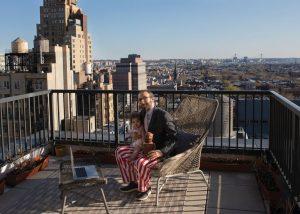 working on balcony with kid