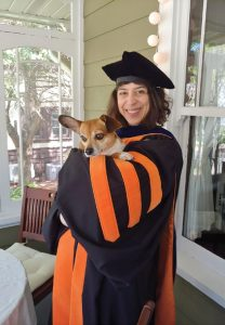 professor mitra sharafi in robes with dog