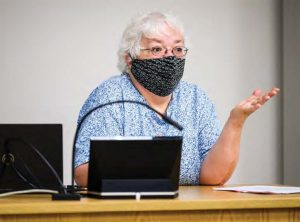 professor Kathie Hendley teaching masked